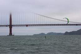 Photo of San Francisco San Francisco Bay Sunset Catamaran Cruise Kitesurfer versus the Golden Gate Bridge