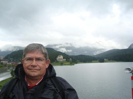 Photo of Milan Swiss Alps Bernina Express Rail Tour from Milan Gary with the Lake behind him