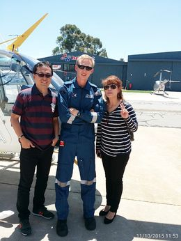 My Husband, Pilot and I.....just after the heli ride....Awesome! , DIANA B - December 2015