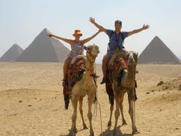 My wife and I riding camels in front of the Giza Pyramids., Hasan Cagri E - July 2009
