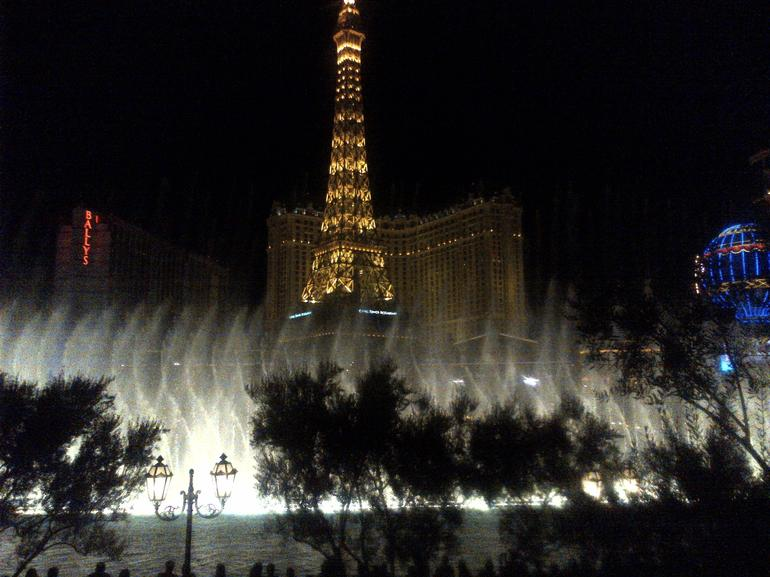 Dancing Lights of Bellagio's with the Paris Tower in the background - Las Vegas