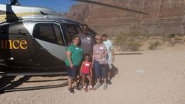Our pilot, Patrick, took this great picture of our whole family by the helicopter in the canyon. , marjorie s - June 2016
