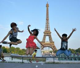 Photo of Paris Paris City Tour, Seine River Cruise and Eiffel Tower My kids jumping shot.