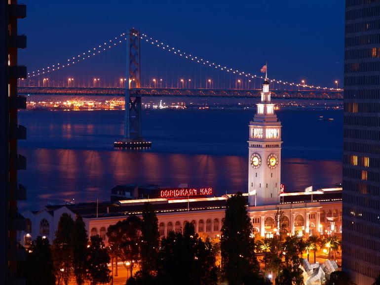Night scene of Ferry Building & Bay Bridge - San Francisco