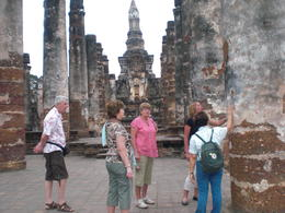 Exploring the ruins of Sukhothai with the guide - March 2013