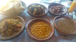 Beautiful chicken tagine, mixed salad, lentils, beans, meatballs, cous cous with veg and plenty of bread and oil. Drinks are extra but not a bad price about 30/40 dirhams 2/3 for a small beer to..., Roy T - December 2015