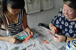 Photo of Beijing Private Cultural Tour: Hutong Rickshaw Ride, Tea Ceremony and Dumpling Making in Beijing Paper cutting in the Hutongs