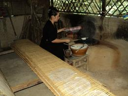 Photo of Ho Chi Minh City Cu Chi Tunnels Small Group Adventure Tour from Ho Chi Minh City making rice pancakes