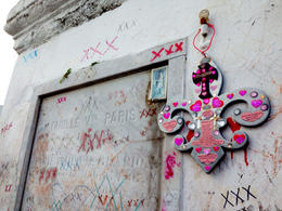 The grave of Marie Laveau, covered in kisses and voodoo symbols. , Rusty - November 2013