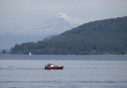 Photo of   Red boat on Puget Sound with Mt Baker in background
