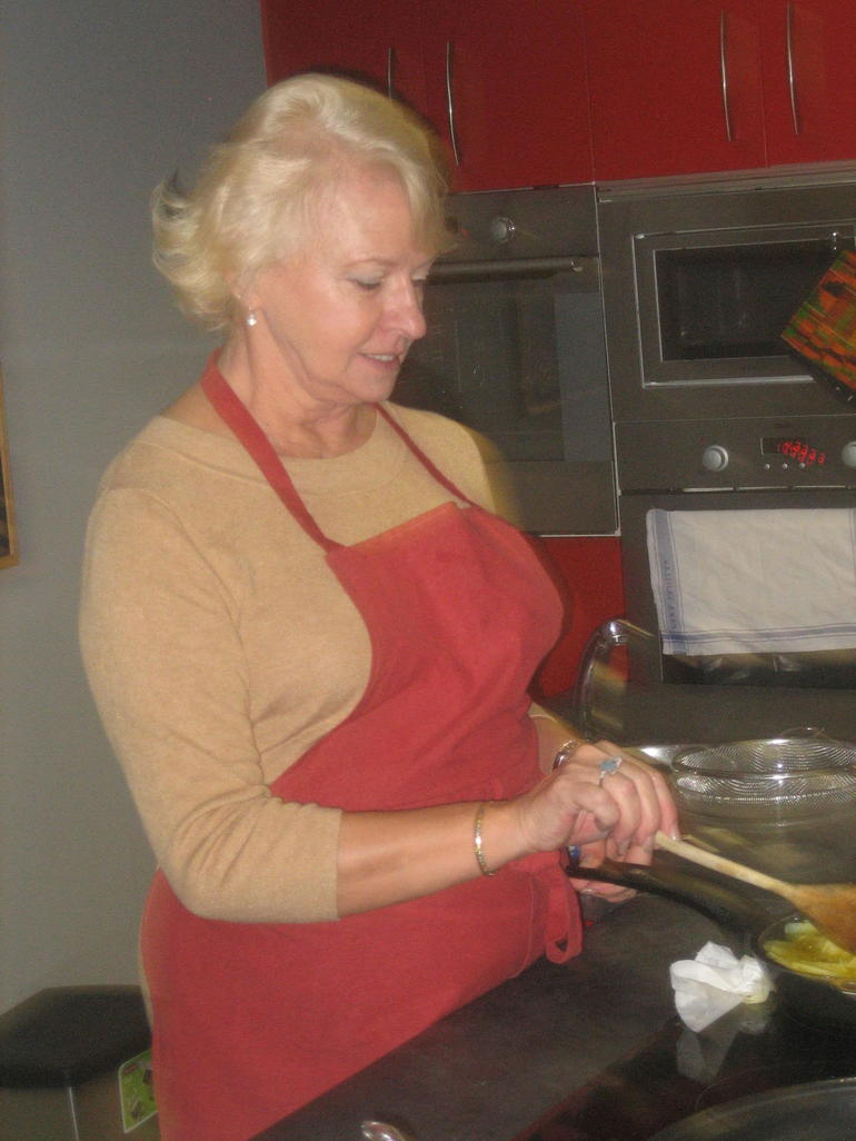 Cooking potatoes and onion for tortilla - Madrid