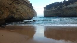 This photo was taken at Loch Ard Gorge. Wonderful reflection of cliffs and sea water! , Warren - August 2015