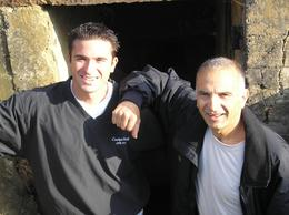 Mike and John in front of bunker door that was blown out by Ranger bazooka., John J - October 2007