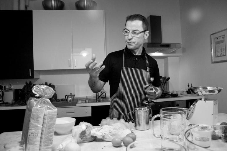 Chef Giovanni explaining how to make cappuccino with simple tools - Florence