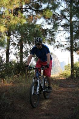 Photo of Guilin 5-Day Small-Group Yangshuo Bike Adventure with Rock Climbing, Hiking, Kayaking or Cooking Class Downhill
