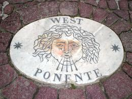 How did this paving stone get in St Peter's square with the English word for West instead of Italian?, Terence O - October 2012