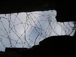 Inside the bunker, with rusting barbed wire., John J - October 2007
