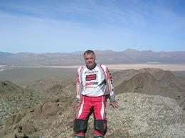 Photo of Las Vegas Hidden Valley and Primm Extreme Dirt Bike Tour Brian having break. Scenery stunning.