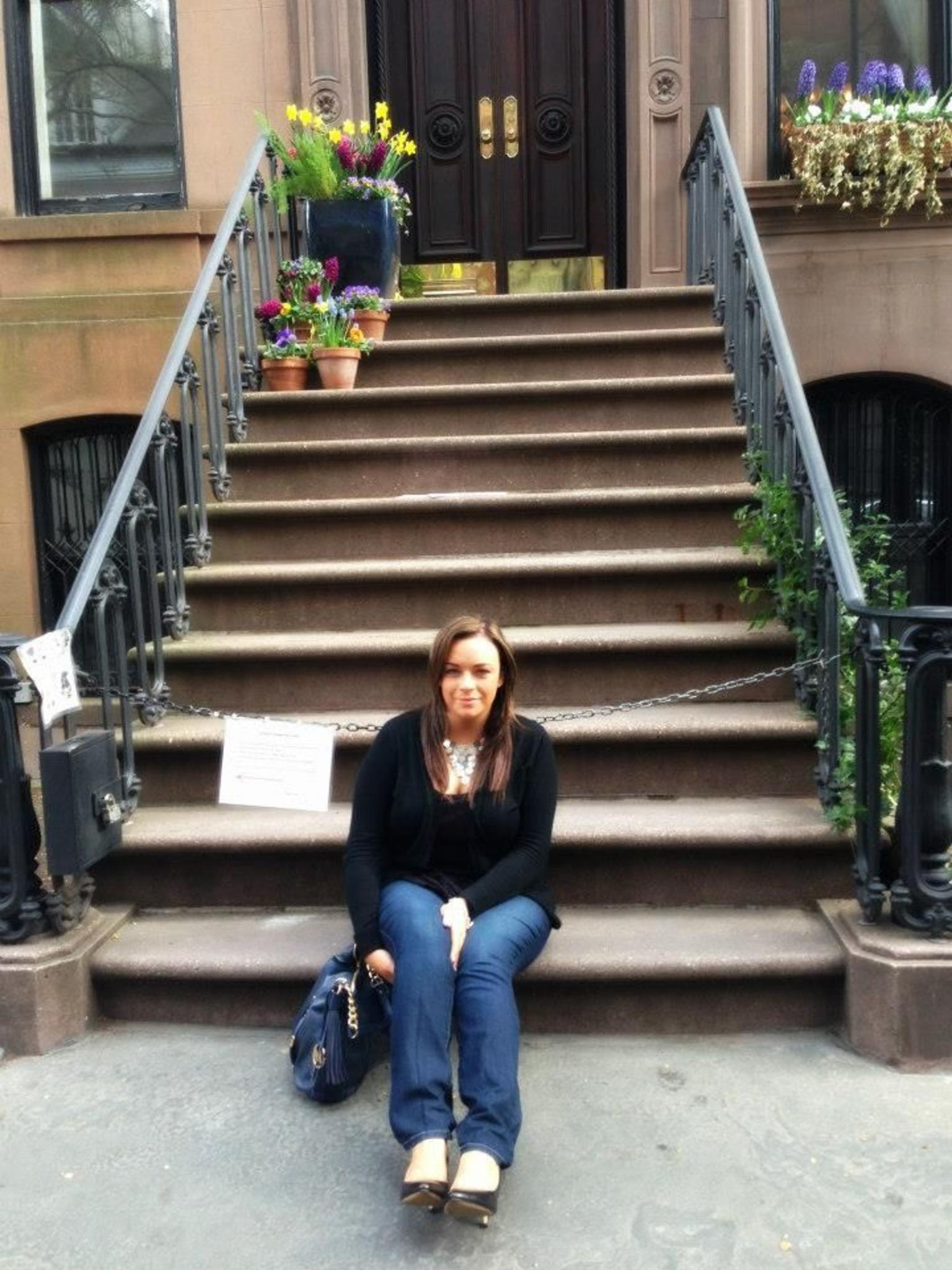 me sitting at the  and quot; stoop and quot; of Carrie's apartment.