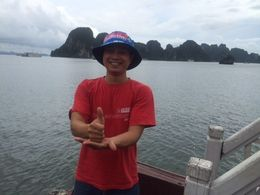 Cuong my tour guide at Halong Bay with a NQ Cowboys supporters cap Australian NRL premiers 2015 , Jennifer L - October 2015