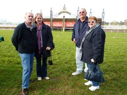 Len, Sue, Mick & Pat standing on the race track at Flemington. We saw the Stewards room, the members area and walked in the horses show arena. This is great for people who love the Races, to see ... , Len L - May 2010