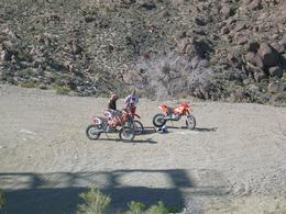 Photo of Las Vegas Hidden Valley and Primm Extreme Dirt Bike Tour Brian and Seth discussing tactics.