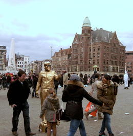 Amsterdam's city center, the lively Dam Square, with its iconic buildings and street performers. , Sandeep S - April 2012