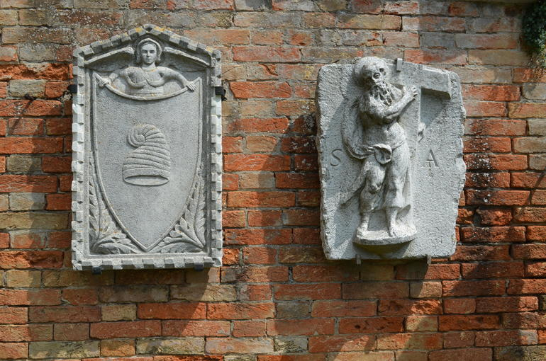 Crests outside Palazzo del Archivo - Venice