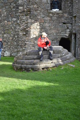 Photo of Edinburgh West Highland Lochs and Castles Small Group Day Trip from Edinburgh Kilchurn Castle- Tour Guide playing the bagpipes!