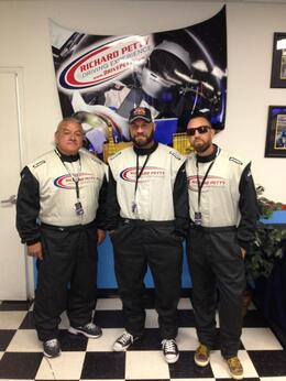 MMA Fighter - Randy Couture, Ben Carey of Lifehouse and Rocky Hopkins all suited up and ready to race some NASCARs!, World Traveler - November 2013