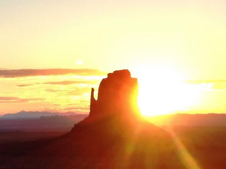 the sun rising behind Monument Valley - Las Vegas