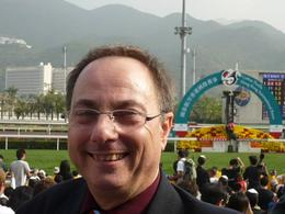 Robert at Shat Tin International Horse Racing Dec 2009 in the background is the Winning Post., Robert W - December 2009