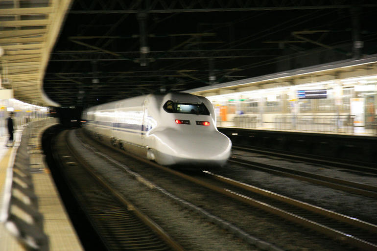 A bullet train screams by. - Tokyo