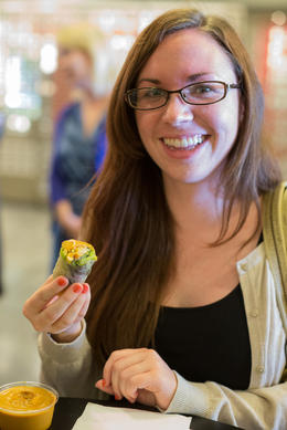 Enjoying a yummy spring roll, Viator Insider - June 2014