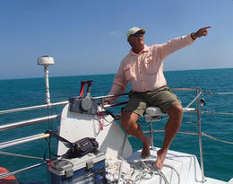 Our seasoned captain points out dolphins. - June 2013