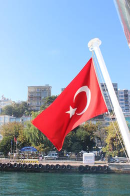 Photo of Istanbul Istanbul City Tour with Bosphorus Strait Sightseeing Cruise Turkish flag on the boat.