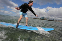 Photo of Oahu Oahu Surf Lessons: Class and Equipment at Ala Moana Beach with Round-Trip Transport He's off!