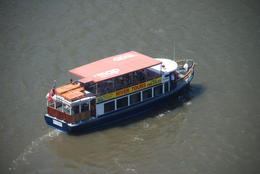 The little tour boat, having dropped us off, make off for its next journey. Taken from the Brisbane Wheel. , Geoffrey S - January 2015