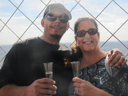 My husband and I sipping champagne at the top of the Eiffel Tower. , Deanne S - October 2014