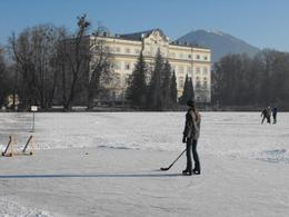 Ice hockey player on frozen lake in front of Leopoldskron Castle - March 2010