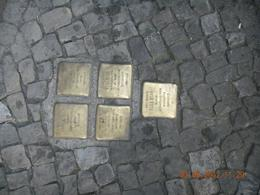 """On every street in the old jewish quarter you can see this tiny """"memorial plates"""" in betwen the stone pieces of the walkways. Each one is dedicated to a person killed at an extermination..., Leon - September 2012"""