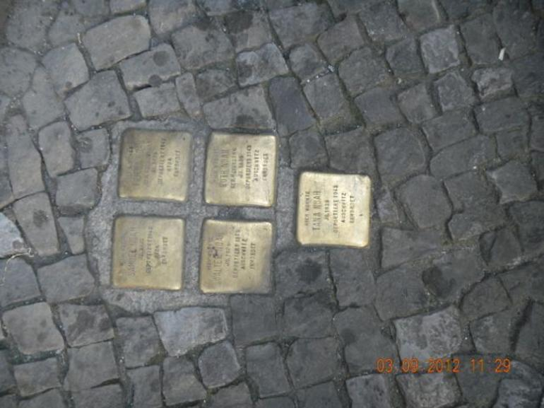 "On every street in the old jewish quarter you can see this tiny ""memorial plates"" in betwen the stone pieces of the walkways.Each one is dedicated to a person killed at an extermination camp who used to live in that address."