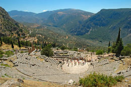 Tourists at the Delphi theatre - view of the entire sanctuary and the valley below. - May 2011