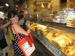 Photo of Florence Small-Group Florence Food Walking Tour Our guide Coral picking out some great Florence breads!