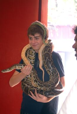 A brave member of our party poses with some of the snakes inside the Temple. , Peter T - May 2011