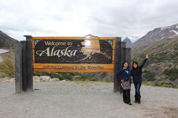 Me and my travel buddy on the Welcome to Alaska sign , GRACE C - September 2014
