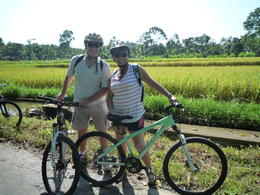 Geoff and Lyn having a rest in front of one of the many rice fields we rode past. , Coopwell - May 2011