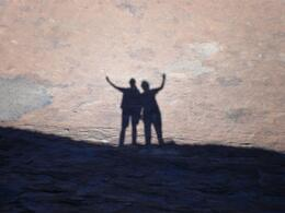 A picture of our shadows cast on the very spiritual Uluru, Ann C - July 2009