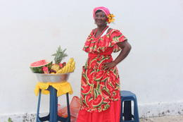 One of the many women selling fruit in Cartagena. They are the descendents of the slaves that lived in Las Bovedas. Ended up taking pictures with her and buying some fruit!, Bandit - September 2012