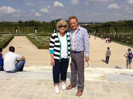 My husband and myself beginning the tour of the gardens of Versailles. Absolutely beautiful! , Nancy D - September 2014